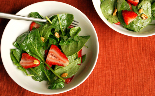 Photograph of spinach and strawberry salad with poppy seed vinaigrette by Personal Chef, Lacey Stevens-Baier, of Sweet Pea Chef, and the food blog, a sweet pea chef