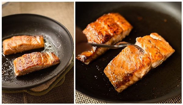 Close up photos of pan fried salmon cooking in a skillet before being placed in the oven to finish.