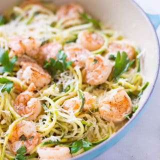 Side view of the 15 minute healthy shrimp scampi which has been garnished with fresh parsley and is ready to eat.