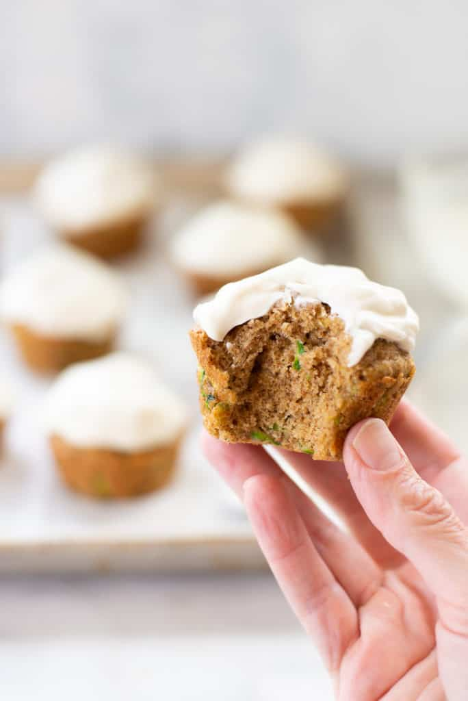 Looking for a sweet muffin recipe that is also healthy? These Sweet Zucchini Muffins With Greek Yogurt Frosting are fluffy and moist–and the answer to adding more vegetables to your day!