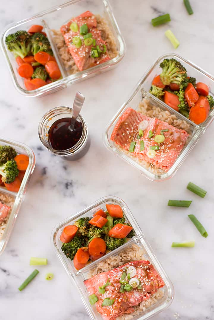 Overhead view of meal prep containers with teriyaki salmon for meal prep.