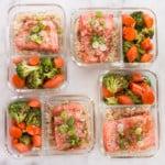 Square image of 4 teriyaki salmon meal prep meals with steamed brown rice and teriyaki veggies.