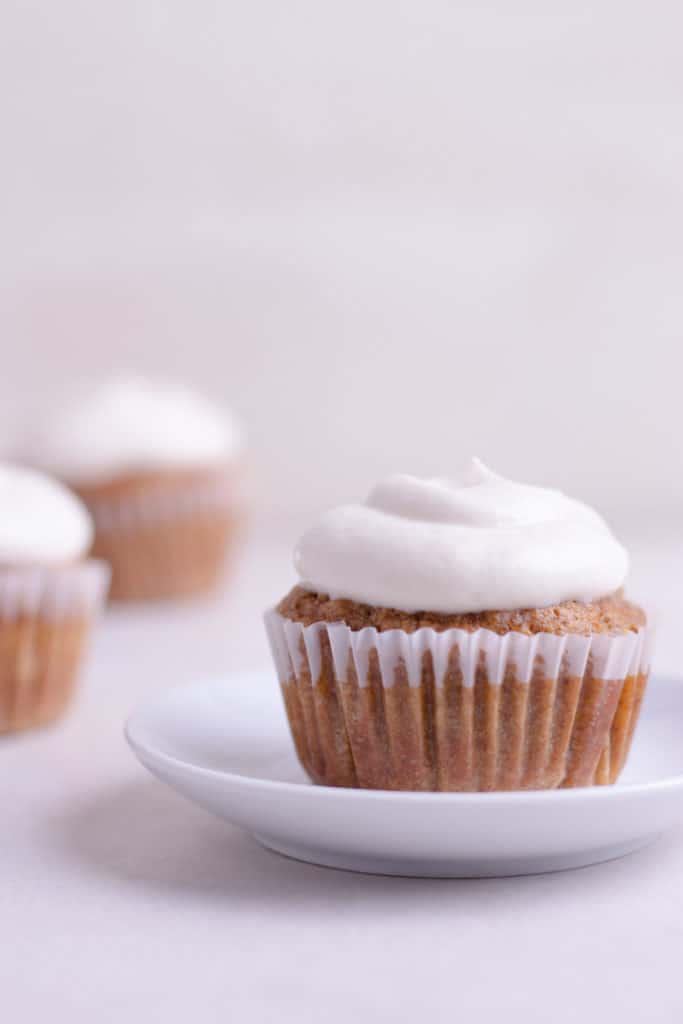 Looking for a can't resist, delicious cupcake recipe? You've found it! This healthy carrot cake cupcake recipe contains applesauce and maple syrup, making them naturally sweetened and extra moist. You're going to love them!