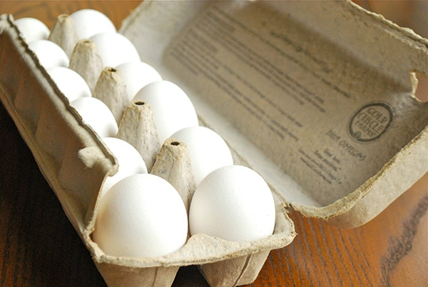 Overview of a carton of white eggs as mentioned in10 Foods That Cause Inflammation; eggs are inflammatory to some and not to others.