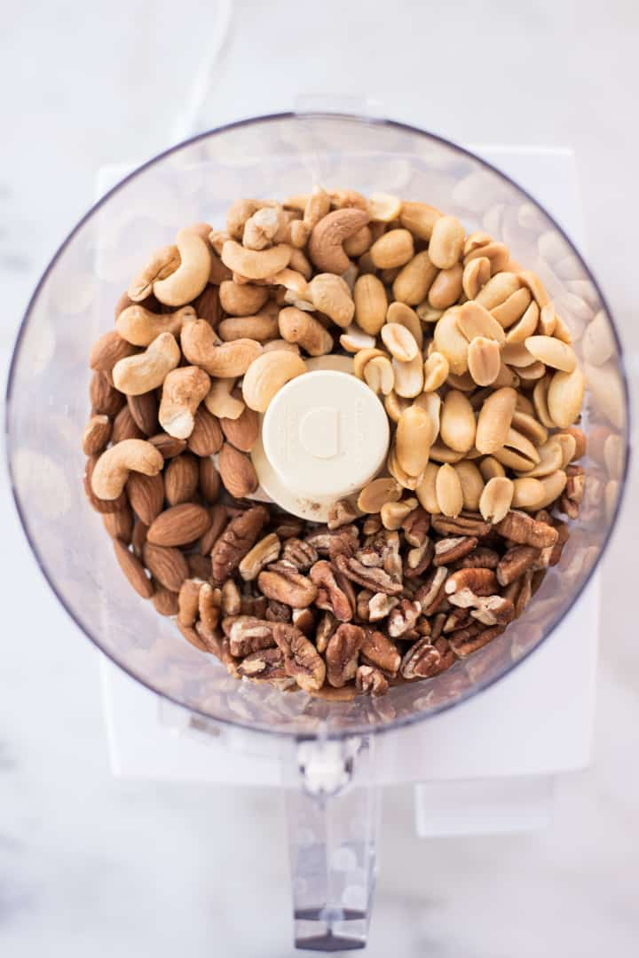 Overhead view of a food processor full of nuts, ready to be chopped for the Homemade Granola Bars.