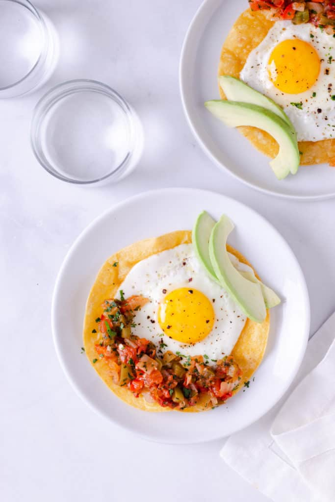 Are you looking for a hearty breakfast? This extra-tasty Huevos Rancheros Recipe is full of Mexican flavors, super healthy, and easy to make!