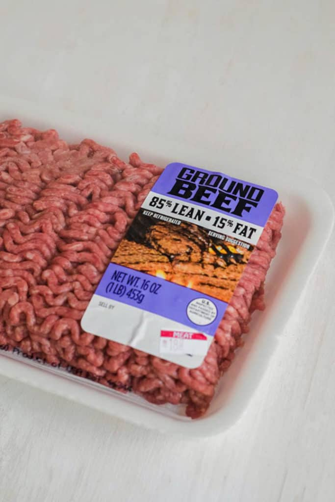 Close up view of a package of ground beef,85% lean and 15% fat, uncooked.