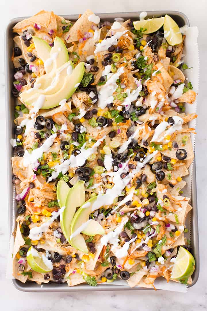 Overhead view of sheet pan shredded chicken nachos, ready to be served.