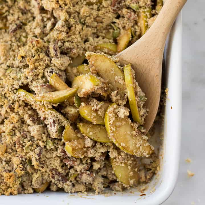Overhead view of Healthy Apple Crumble , including Granny Smith apples, cinnamon, and almond flour, baked and ready to be served.