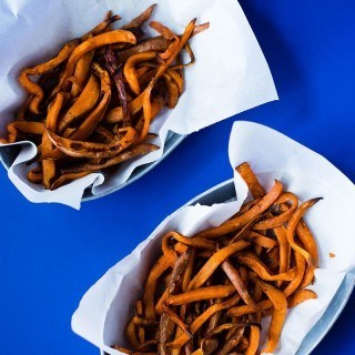 Sweet Potato Fries - A delicious and healthy take on regular fries. Recipe and photo by Lacey Baier from www.asweetpeachef.com #asweetpeachef #fries #sweetpotatofries #healthy #clean