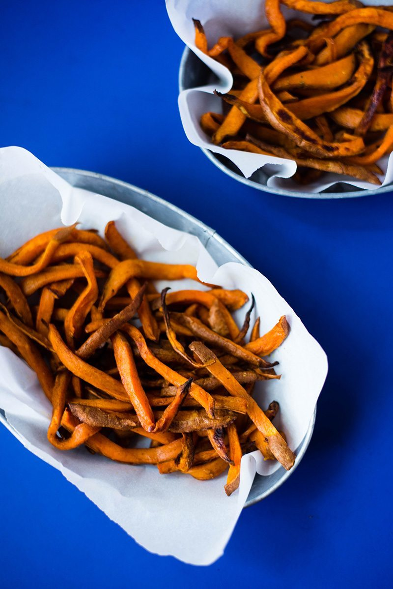 Sweet Potato Fries - A delicious and healthy take on regular fries. Recipe and photo by Lacey Baier from www.asweetpeachef.com #asweetpeachef