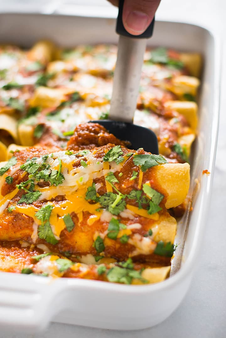 Shredded Chicken Enchiladas | These shredded chicken enchiladas are my absolute favorite enchilada recipe.  Tips for how to make the best chicken enchiladas ever, how to shred chicken, and a handy 10 minute enchilada sauce are all included!  | A Sweet Pea Chef