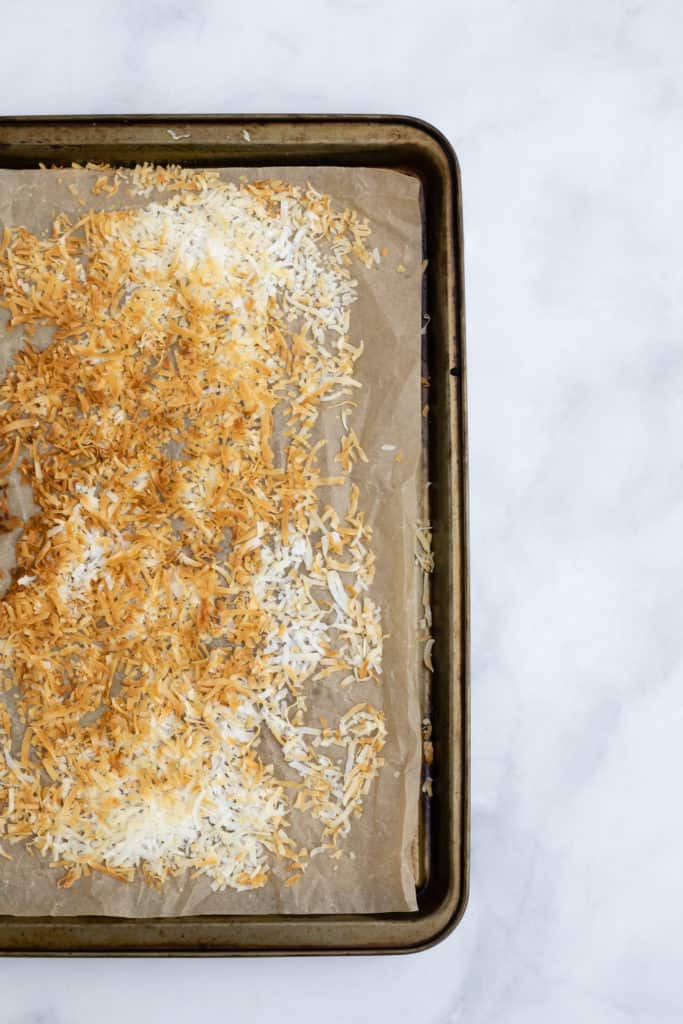 Overhead view of a tray of toasted coconut.