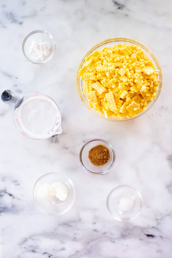 Overhead image of the ingredients for the fresh creamed corn, including full fat coconut milk, coconut sugar, and arrowroot starch.