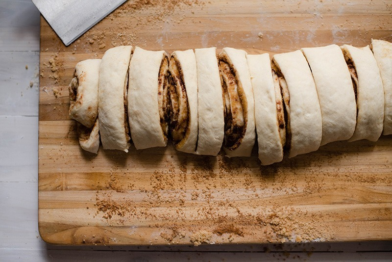 Easy Cinnamon Roll Recipe - Slicing Into Rolls