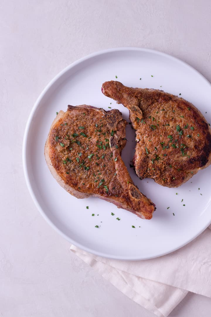 Are you looking for the perfect pork chops recipe? These Best Juicy Pork Chops are easy to make and guaranteed to be moist and savory!