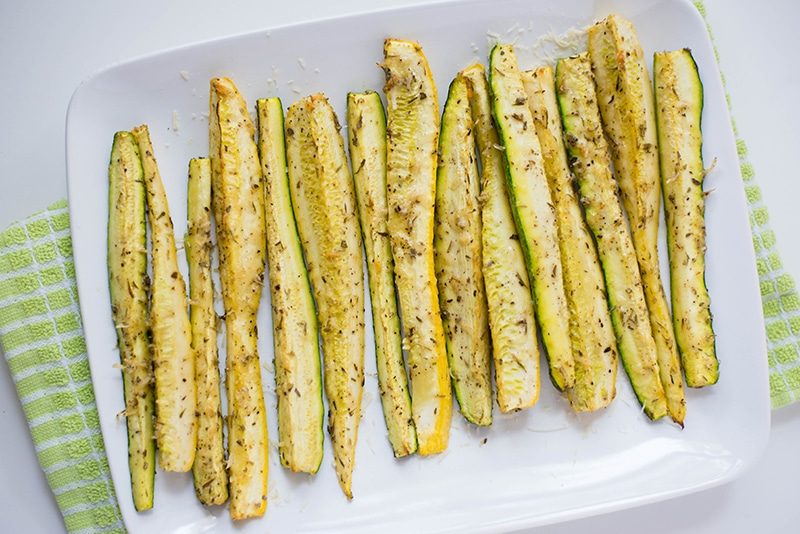 Close up shot of the baked parmesan zucchini and squash spears, ready to eat.