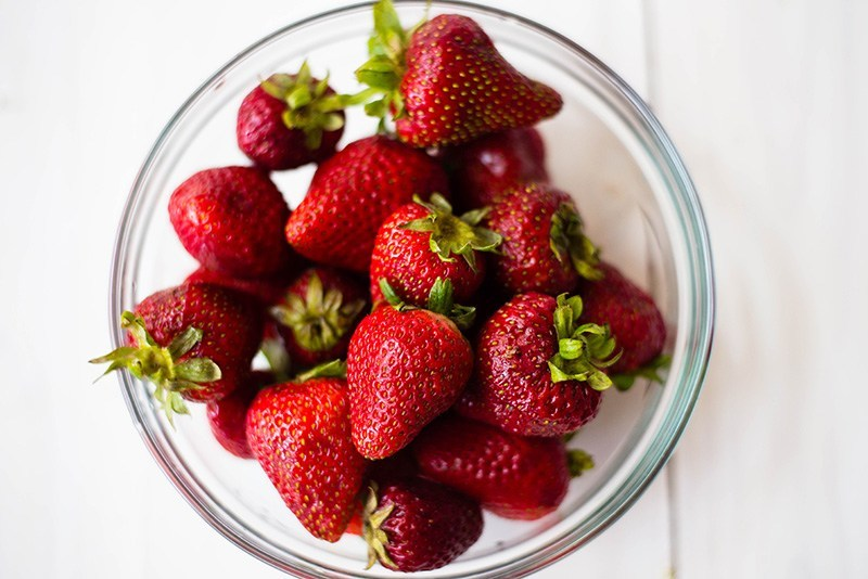 Bowl of fresh strawberries, to be used in gluten-free strawberry shortcake recipe