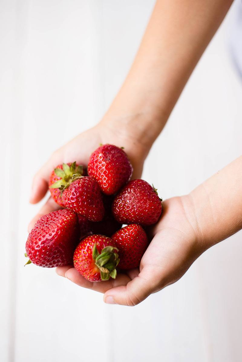 Handful of fresh strawberries to be used to make strawberry shortcake
