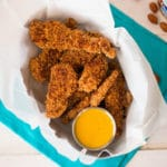 Baked Almond Chicken Strips | Try ahealthy spin on chicken strips with this baked almond chicken stripsrecipe, paired with a clean honey mustard dipping sauce that's pure perfection. | A Sweet Pea Chef
