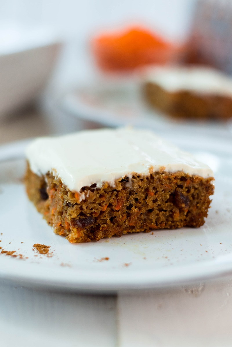 Close up photo of slice of healthy carrot cake on a serving plate
