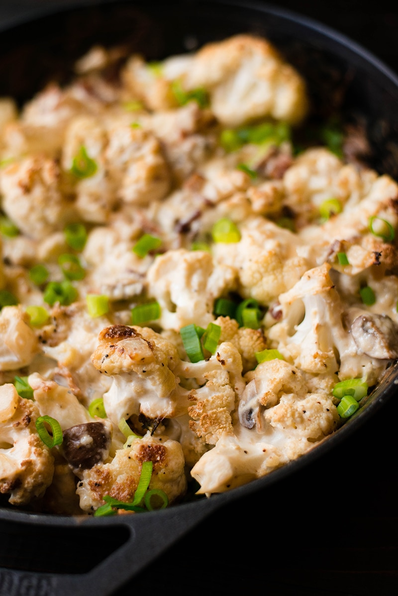 Close up photo of cauliflower gratin dish in ovenproof skillet, ready to be served and enjoyed