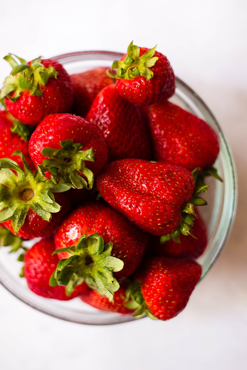 Bowl of fresh strawberries ready to be used in 4 ingredient strawberry frozen yogurt recipe