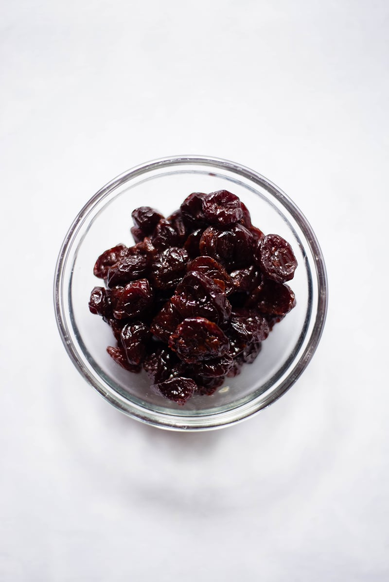 Glass bowl of dried cherries to be used to make dark chocolate cherries energy bites