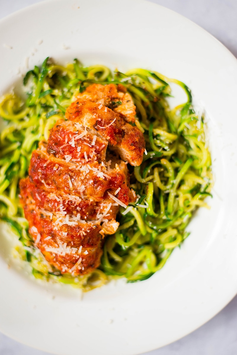 Close up of the healthy baked chicken Parmesan dish, accompanied with zucchini noodles