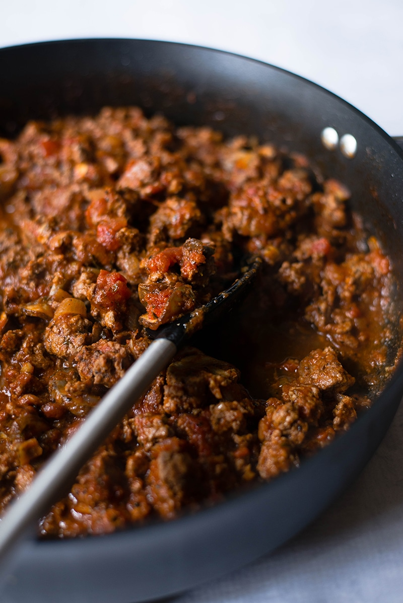 Marinara sauce cooked with ground beef, ready to be used in spaghetti squash bowls recipe