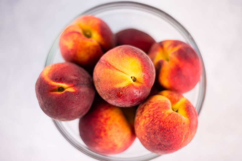 Bowl of fresh peaches used to make peach frozen yogurt recipe