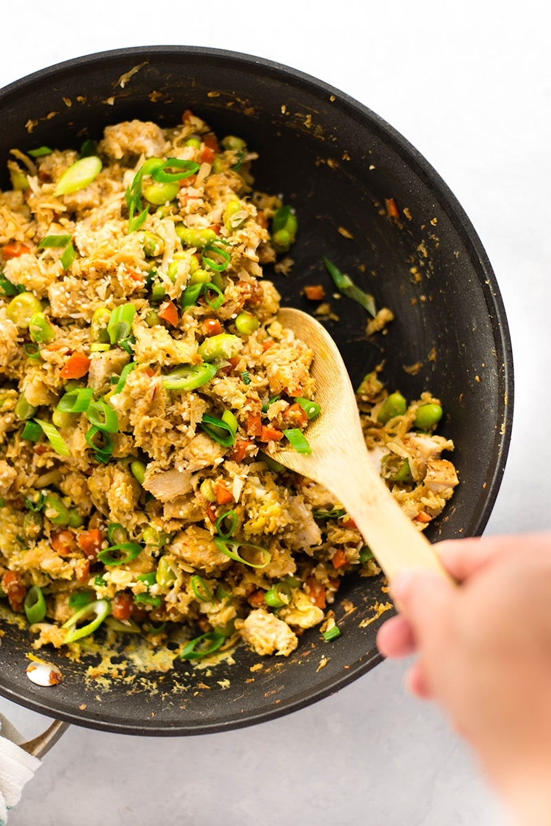 Chicken Cauliflower Fried Rice | Cut the carbs and greasy take-out and still get your chicken fried rice fix with this 25 minute chicken cauliflower fried rice recipe.  Cauliflower fried rice is a delicious, easy, and healthy fried rice substitute!  | A Sweet Pea Chef