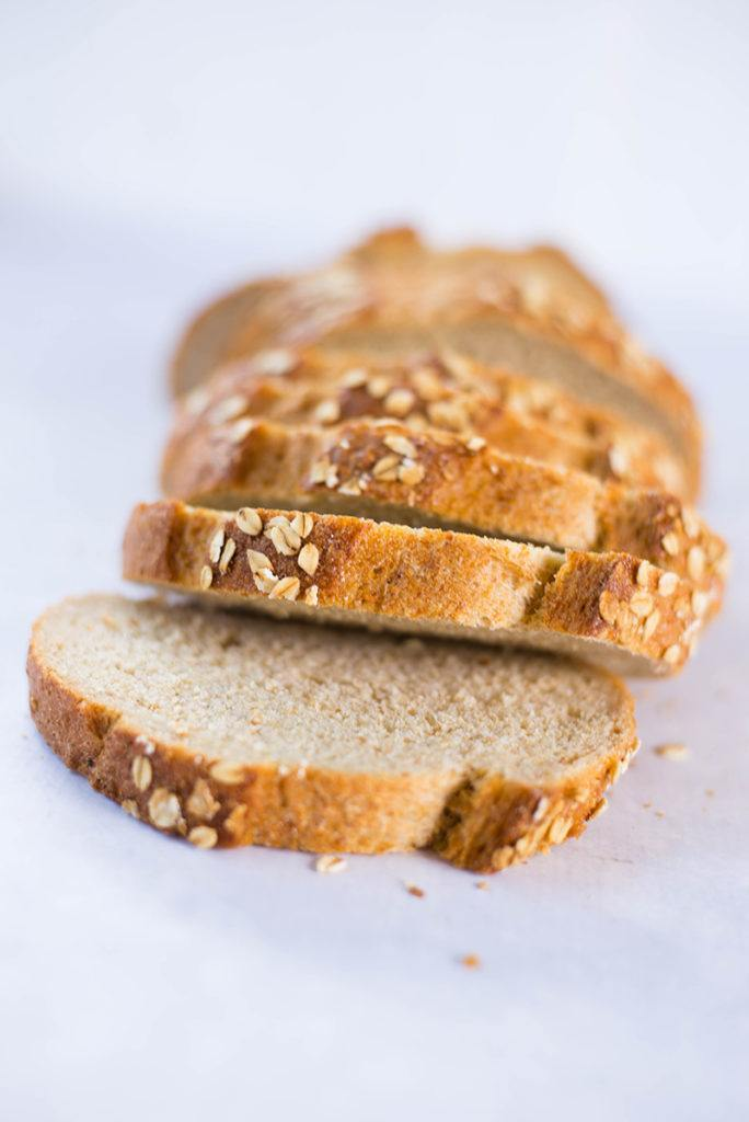Close up image of slices of a best store bought bread, healthy and full of grains.