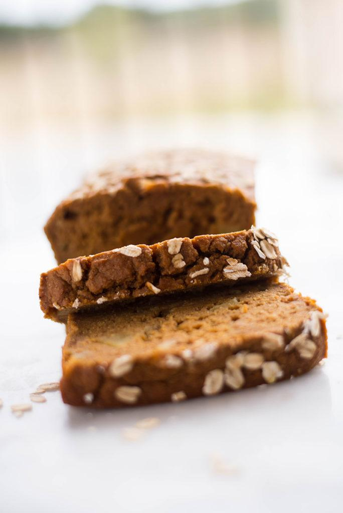 Side view of sliced Apple Pumpkin Bread with oats on top, sliced and ready to enjoy as a Healthy Breakfast Idea.