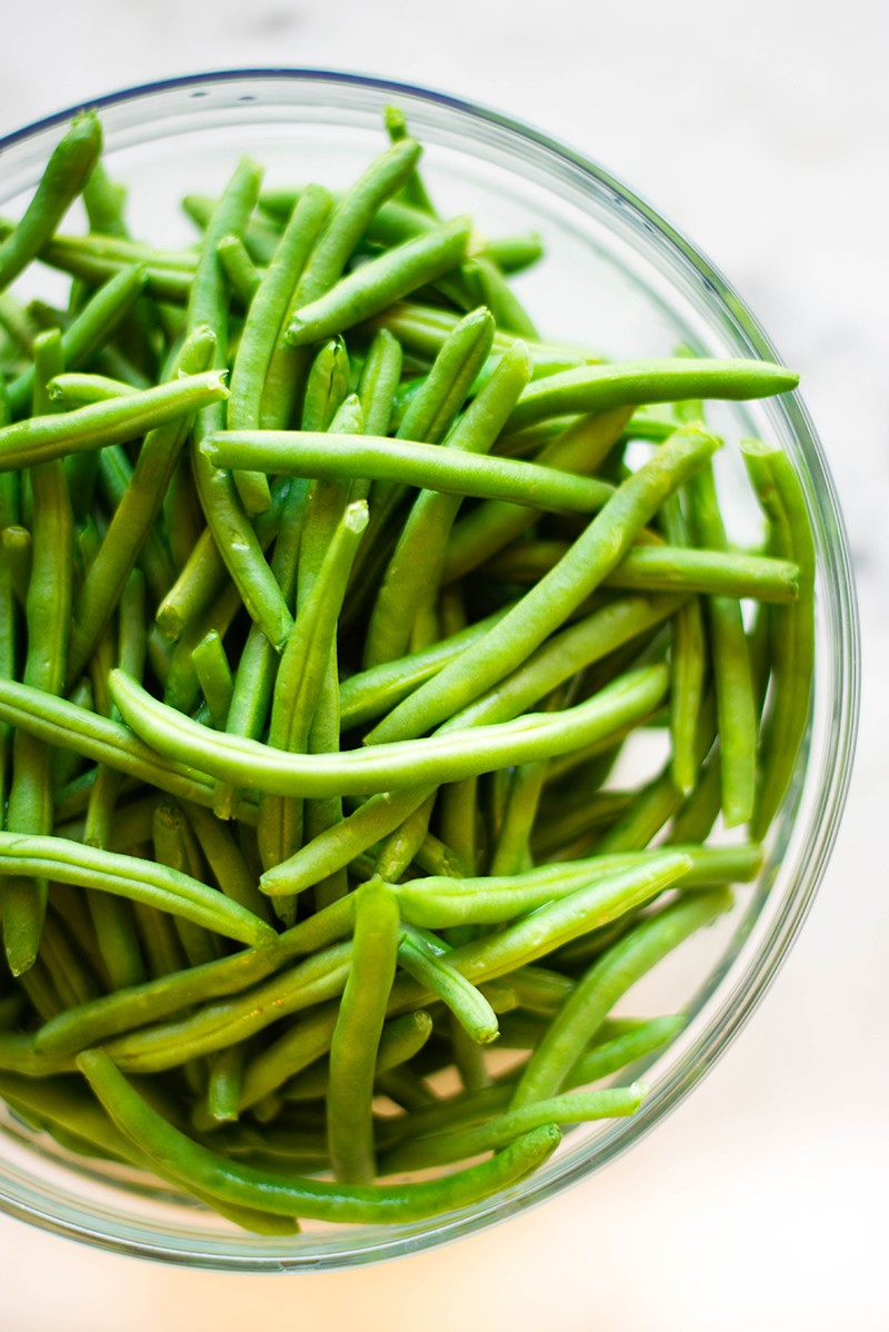 Bowl of fresh green beans, ready to be made into healthy green bean casserole.