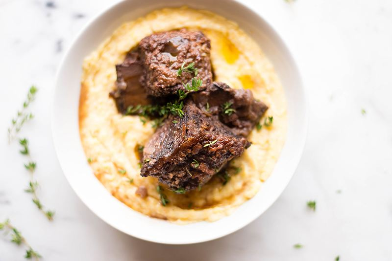 Braised Short Ribs with Creamy Polenta | Got dinner plans for Valentine's Day yet? These Braised Short Ribs with Creamy Polenta will make your love swoon! #sponsored | A Sweet Pea Chef