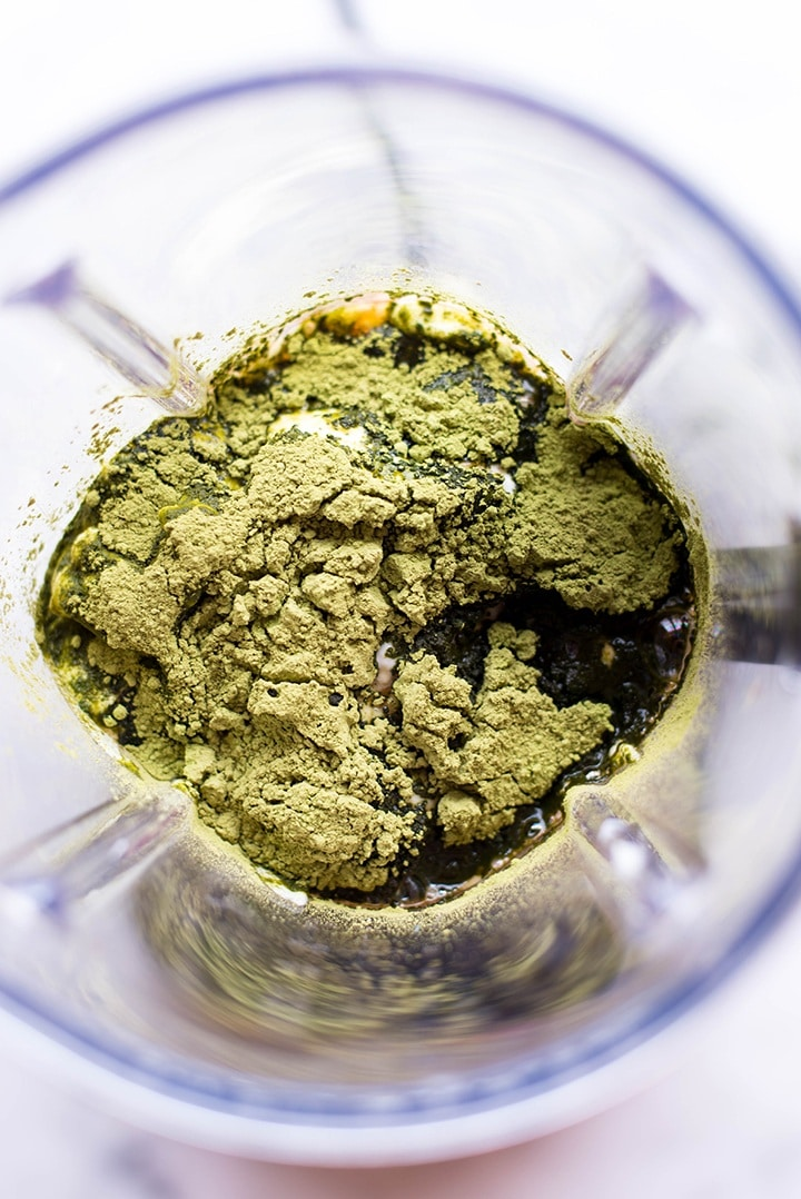 : Green tea yogurt Matcha ingredients poured into a high powered blender, ready to be pulsed into a creamy texture