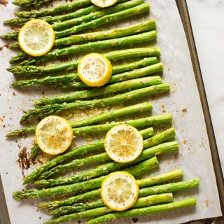 Overhead View of Entire Sheet Pan with Asparagus topped with Parmesan Cheese After Roasting