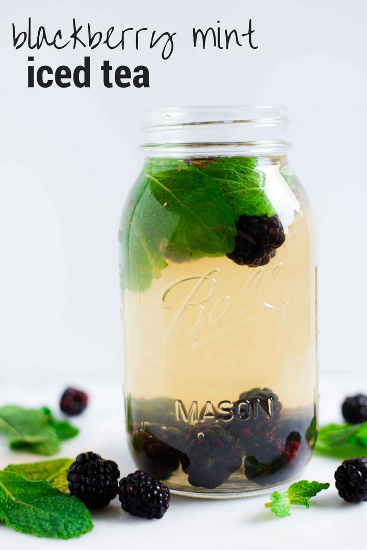 Quart size mason jar with fresh blackberries and mint, ready to drink