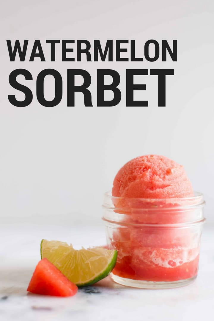 4-oz. mason jar filled with watermelon sorbet with fresh watermelon and lime wedge setting next to it.