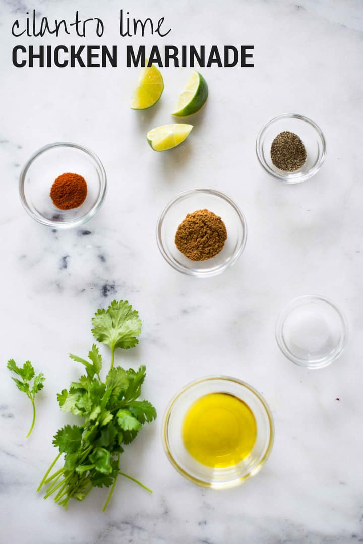 Ingredients separated for cilantro lime chicken marinade, including cilantro, lime, cumin, salt, pepper, and cayenne.