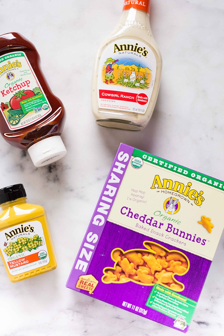 Various items of Annie's Homegrown purchased at Whole Foods Market, including ketchup, organic cheddar bunnies, yellow mustard, and ranch dressing