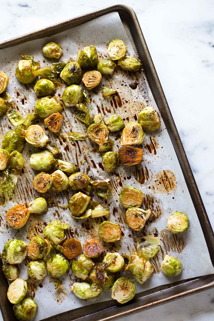 Honey Balsamic Roasted Brussels Sprouts | These honey balsamic roasted brussels sprouts are an incredibly easy side recipe for any weeknight dinner. | A Sweet Pea Chef