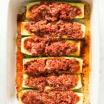 The turkey and quinoa stuffed zucchini boats have been baked in the oven and are ready to eat.