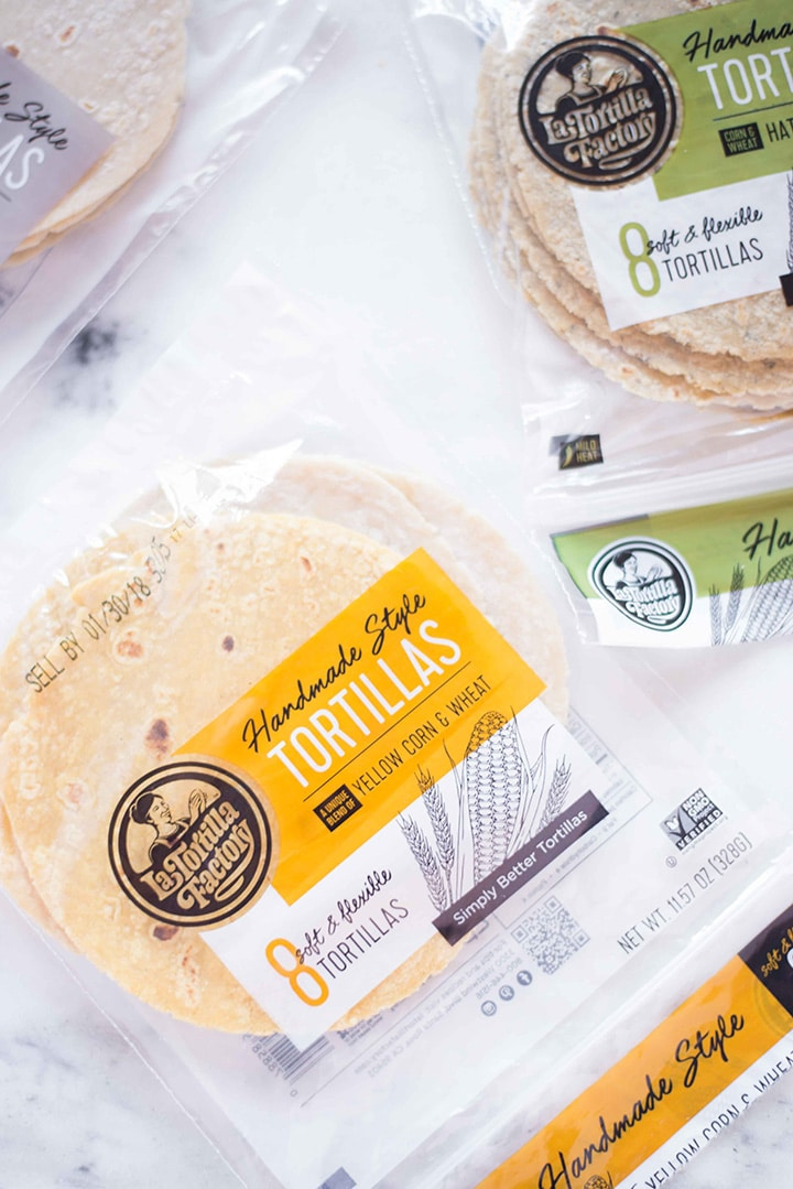 Three bags of La Tortilla Factory Non-GMO Hand Made Style tortillas.