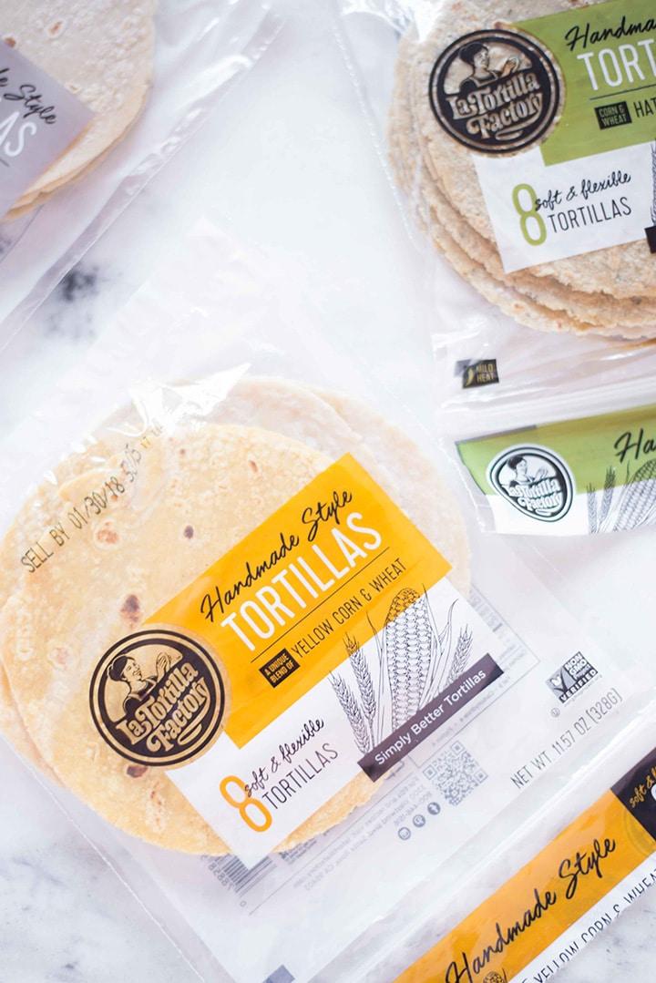 Three bags of La Tortilla Factory Non-GMO Hand Made Style tortillas.