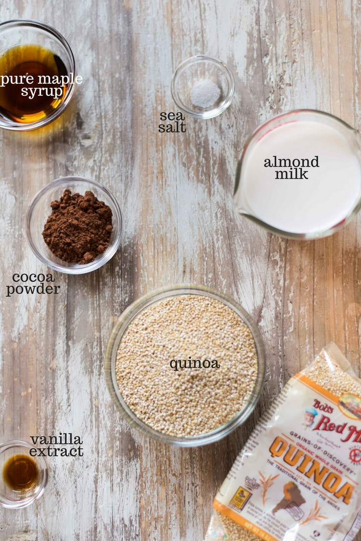 Ingredients necessary to make the Chocolate Quinoa Breakfast Bowl, including raw organic quinoa, unsweetened cocoa powder, almond milk, pure maple syrup, sea salt, and vanilla extract.