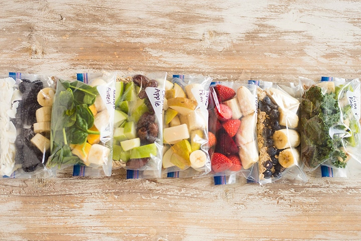 weight loss  weightloss  weight loss programs  weight loss foods  weight loss tips Fruit smoothie freezer packs lined up in a row on a counter, including kiwi and kale, pink power, caramel apple, blueberry muffin, spiced pear, and mango green fruit smoothie packs.