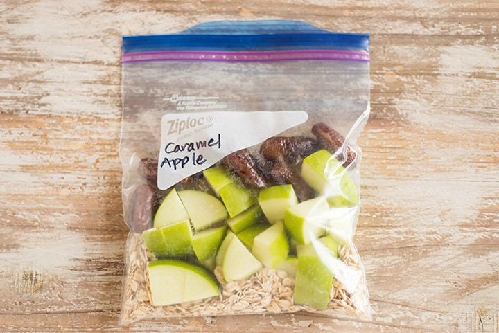 Caramel Apple fruit smoothie freezer pack, which contains rolled oats, diced apple, and dates in a 1 quart sized ziplock freezer bag.