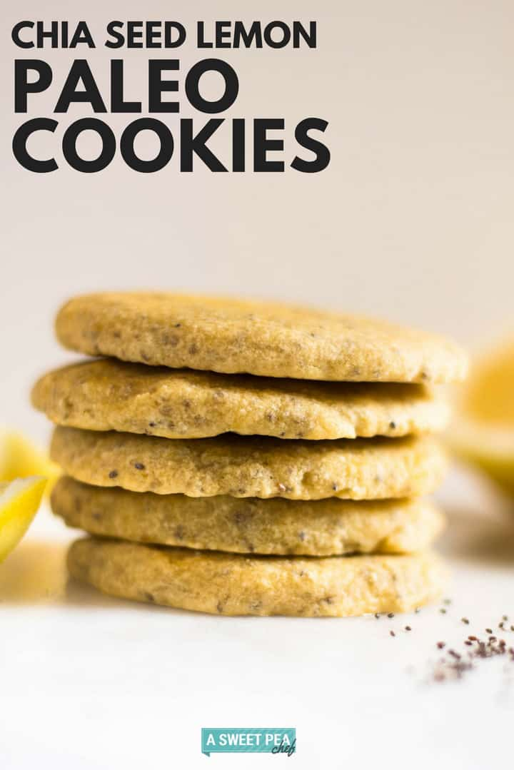 Chia seed lemon paleo cookies stacked on top of each other, setting next to fresh lemon and chia seeds.
